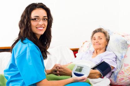 Staff using Sphygmomanometer with patient